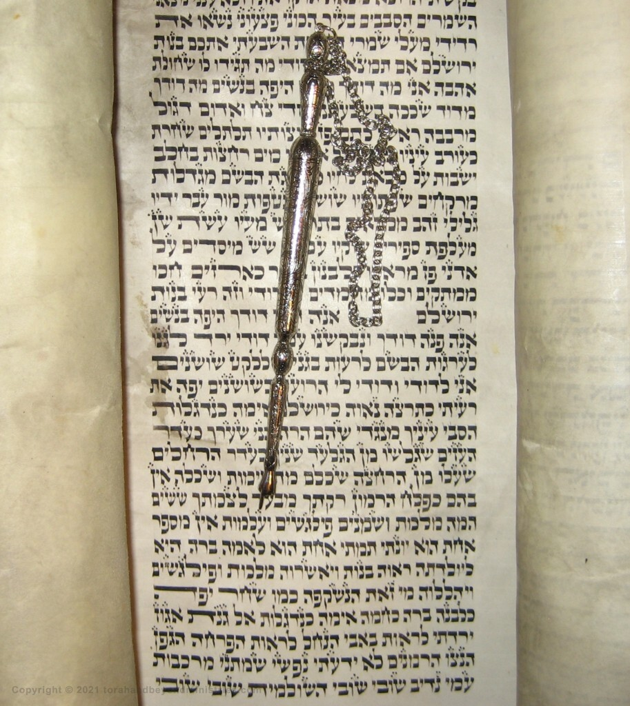 The yad, pointer, is showing the Hebrew word almah which is virgin, the same word used in Isaiah 7:14.