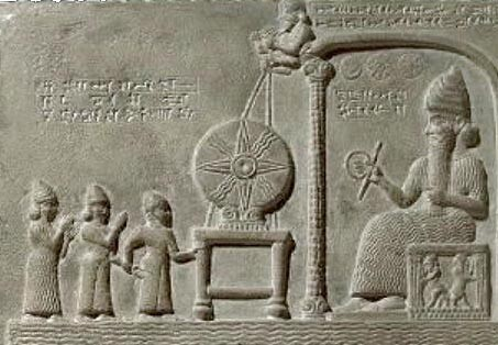Ashur5 measuring rod The sun-god Shamash holding a ring of coiled rope and a rod