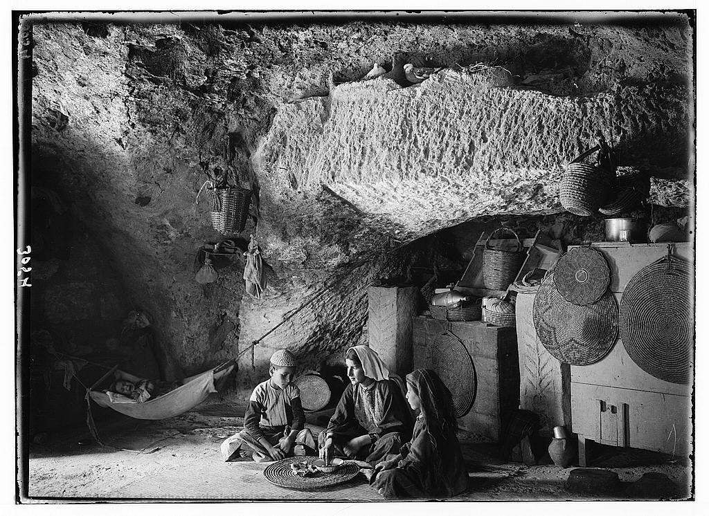 This Family lived in a cave built to shelter animals. The photograph was taken around 1890 near Bethlehem.