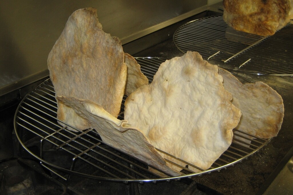 Homemade Unleavened bread cooling on wire racks