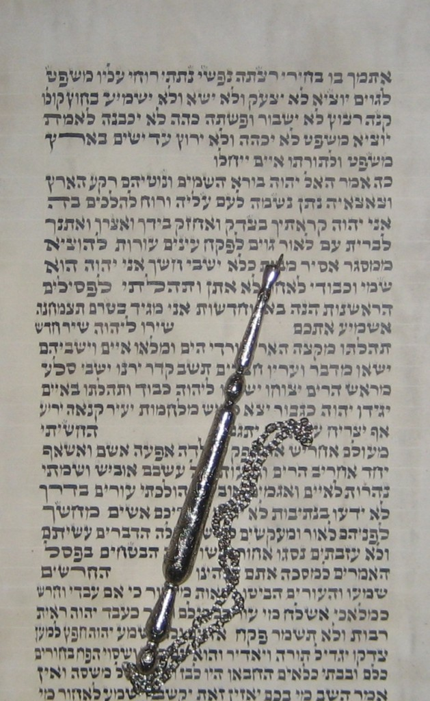 The following photograph is from the Scroll of Isaiah written in Poland sometime in the 19th century. The yad (pointer) is pointing to the word light. This has always been considered to be a Messianic passage from Isaiah.
