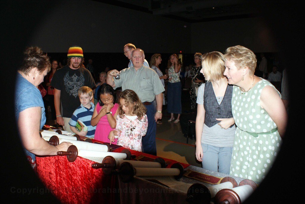 Children viewing Hebrew Scrolls in Dallas, Texas
