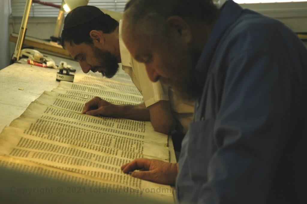 Two Soferim checking a Torah Scroll at Macon OT in Jerusalem