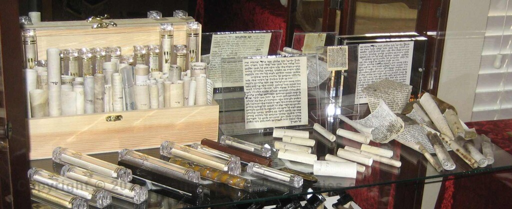 The Mezuzah is a small scroll containing verses from the Torah.