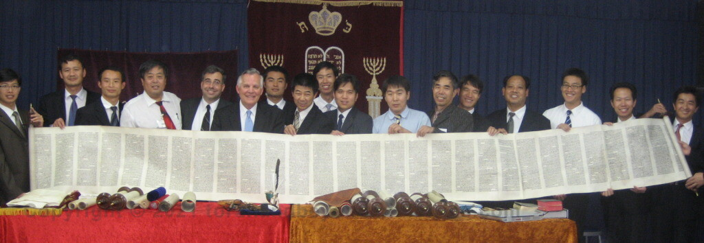 Chinese Pastors holding the Scroll of Isaiah