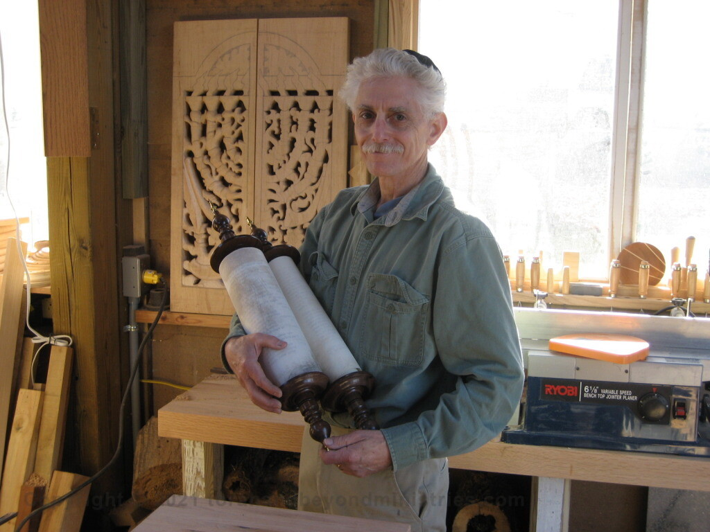 Authentic Scroll of Psalms written in Israel. Dan Katz a master woodcarver made the Etz Chaim for the Scroll.