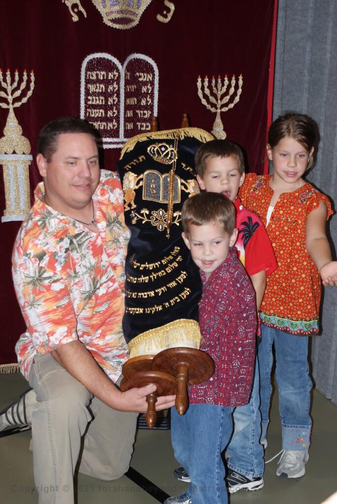 Family holding Torah Scroll at Scroll Seminar in Dallas