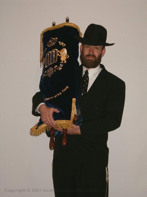 Hebrew Scroll seminar Wisconsin Guest holding Torah Scroll