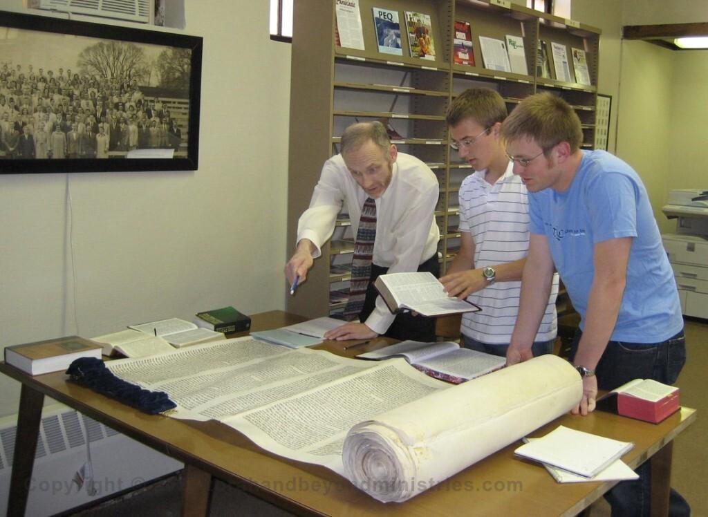 Hebrew Professor teaches from our Torah Scroll