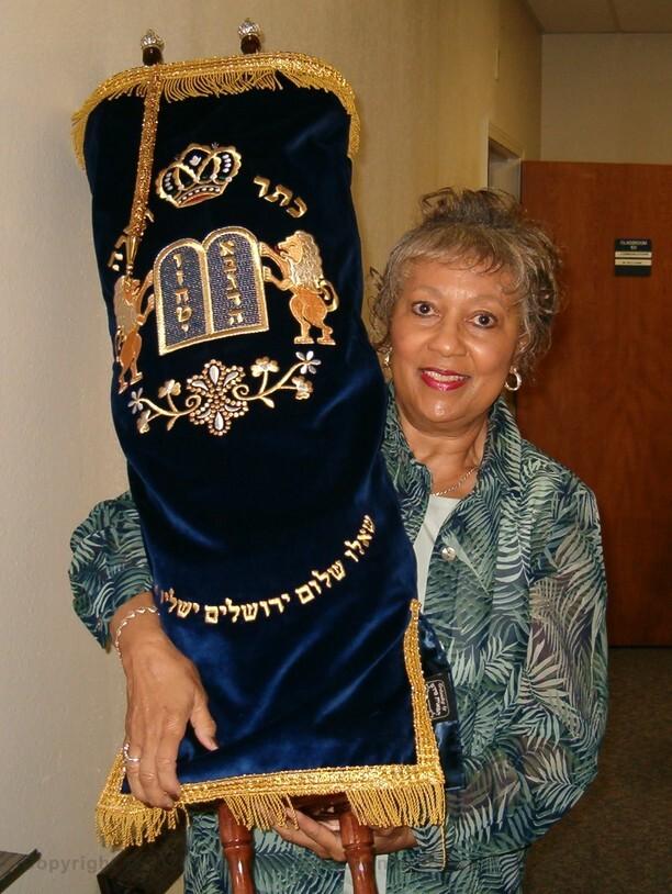 Seminar on Hebrew Scrolls Louisiana Baptist University student holding Torah
