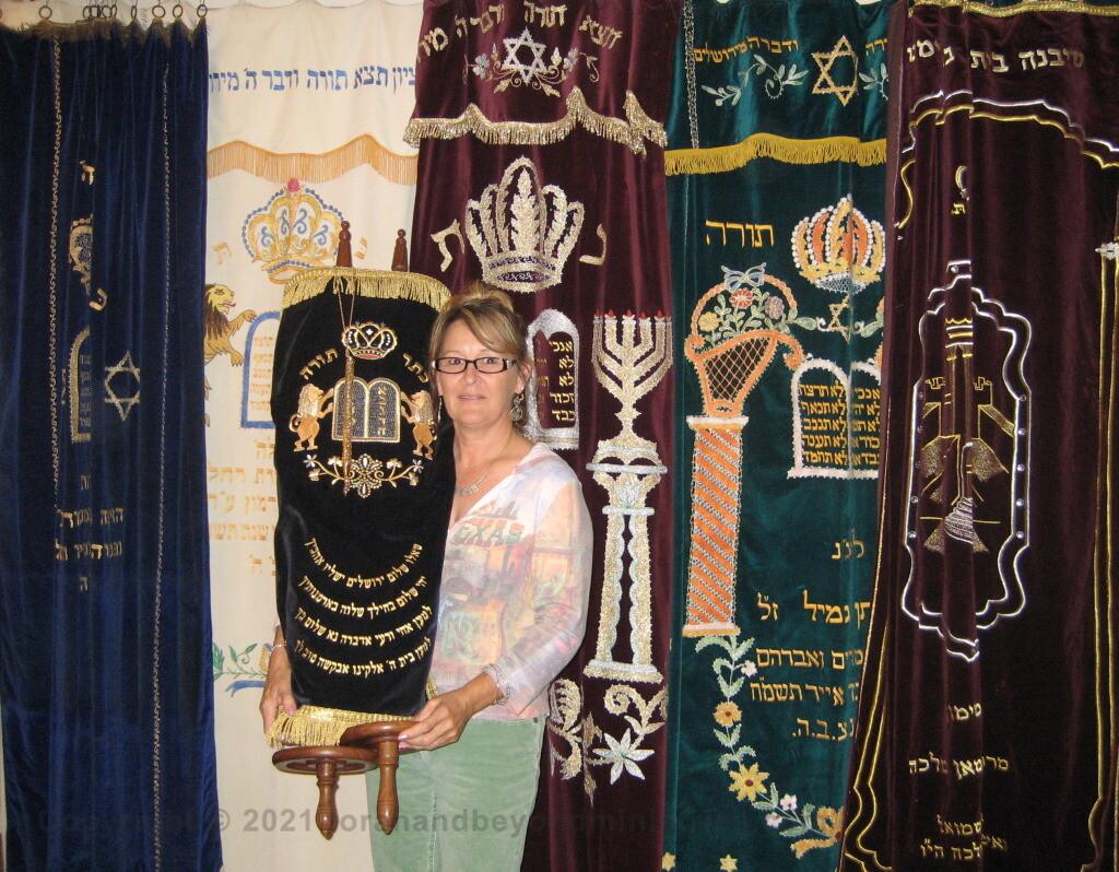 Scriptorium Scroll display guest holding the Torah