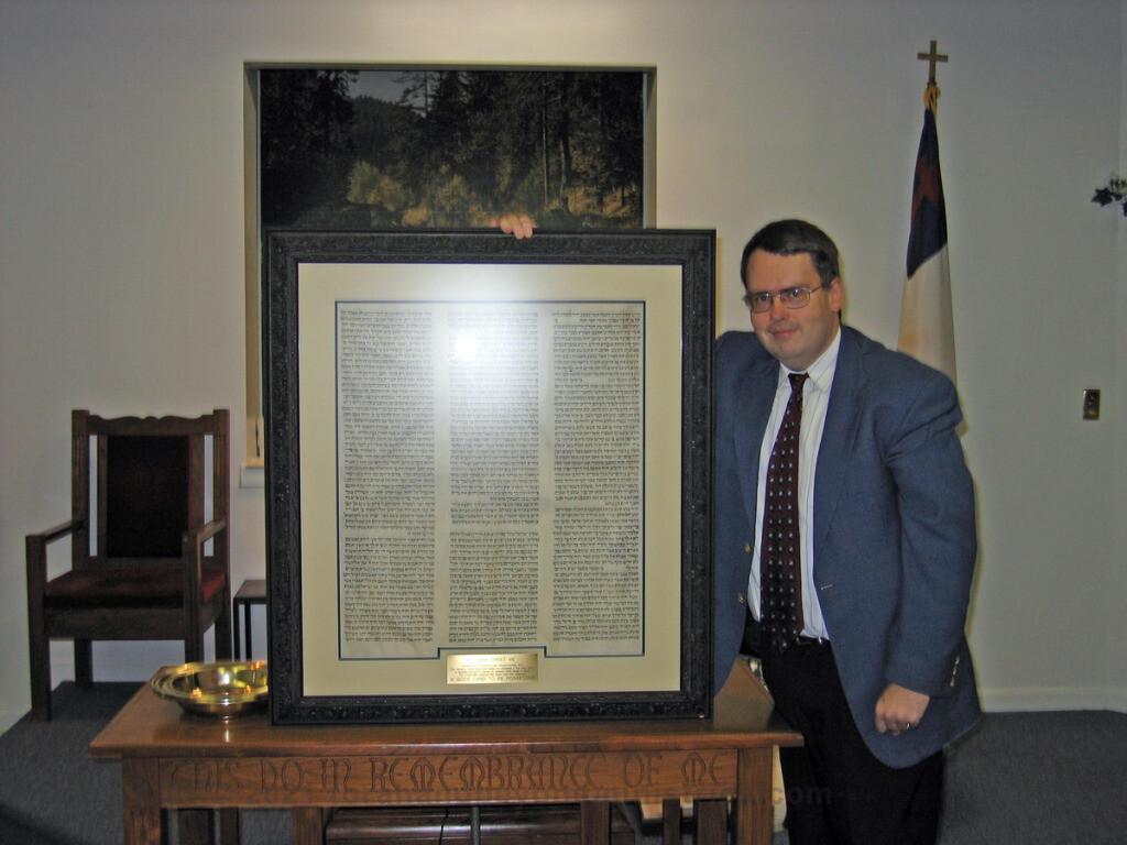 Presenting framed Torah sheet to Baptist church
