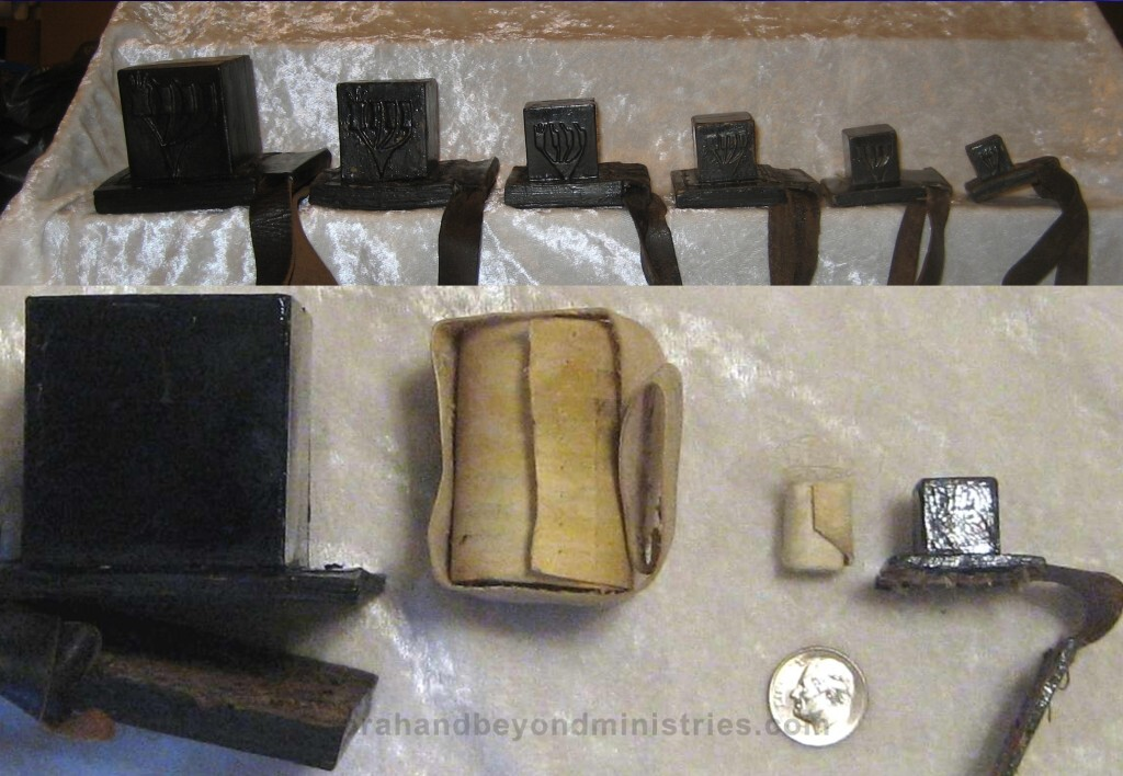 Various size Tefillin also called phylacteries are a set of small black leather boxes containing scrolls of parchment inscribed with verses from the Torah,