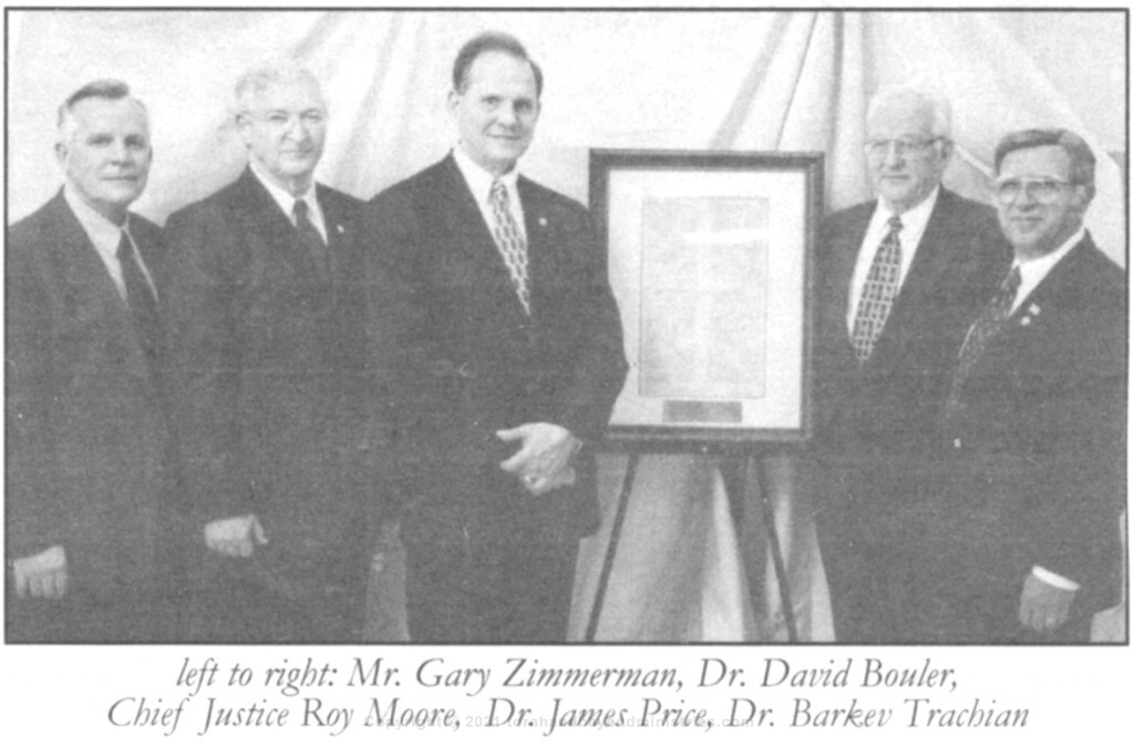 Chief Justice of the Supreme Court of Alabama the Honorable Roy Moore receiving the Ten Commandments from a very old fragmented Torah Scroll written in Yemen in the 1700s.