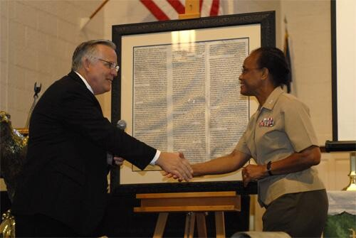 Receiving the Ten Commandments From right to left: Colonel Adele Hodges Commanding Officer of Marine Corps Base Camp Lejeune, Gary Zimmerman
